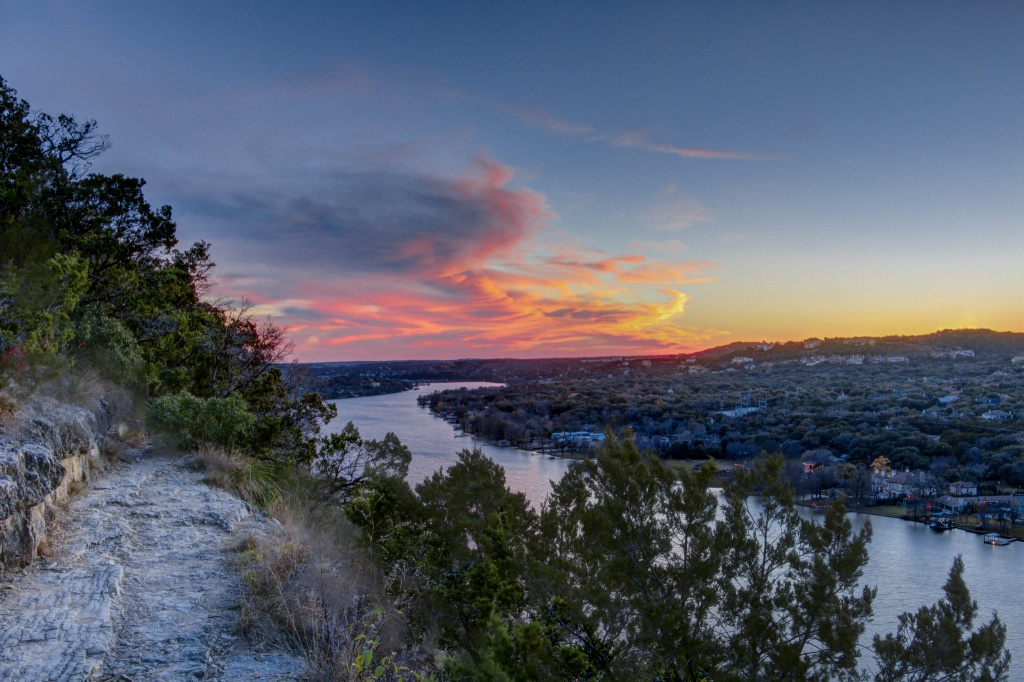 The 102 steps to the top of Mount Bonnell are worth the climb. Visitors are rewarded breathtaking, panoramic views of the city below like this one.